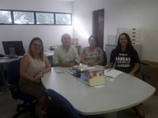 Da esquerda para a direita estão a presidente da CPA, profa. Mônica Dias; o superintendente da STI, Hermes Pessoa; a secretária executiva da STI, Creusa Maria e a estagiária da CPA, Letícia Nascimento.